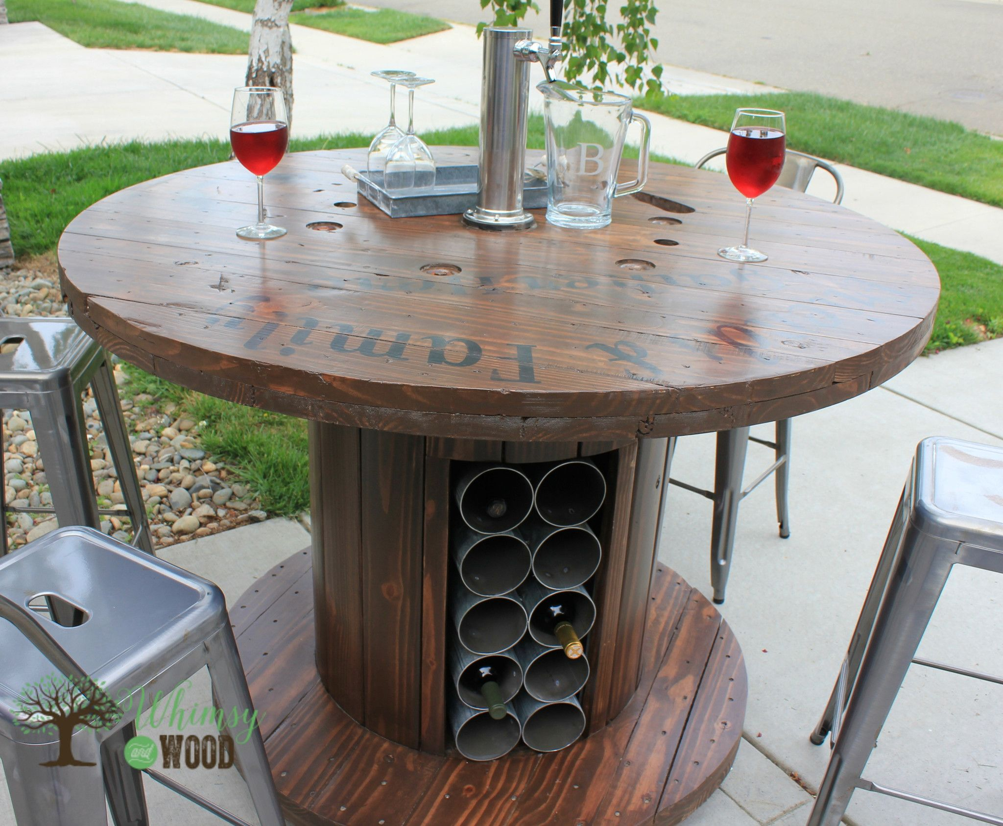 cable reel up cycled, pub height table. with draft tower & wine