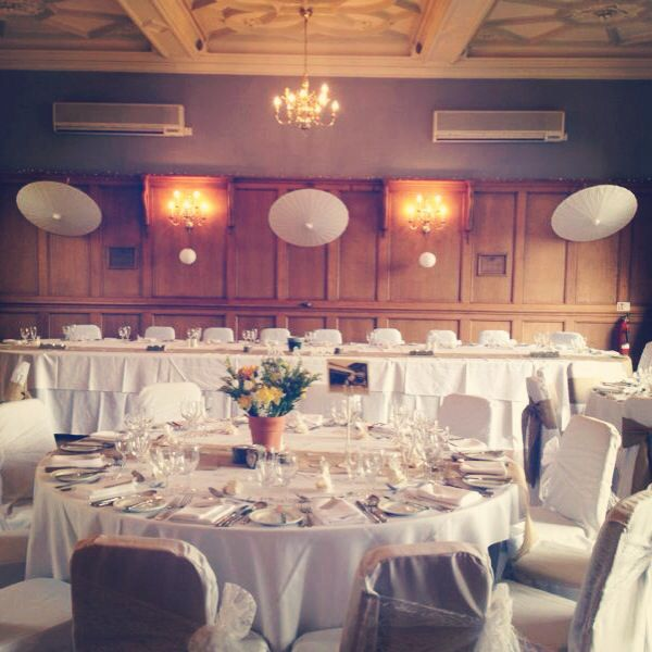 Pretty Paper Parasols hung over the top table at The Maynard, Derbyshire.