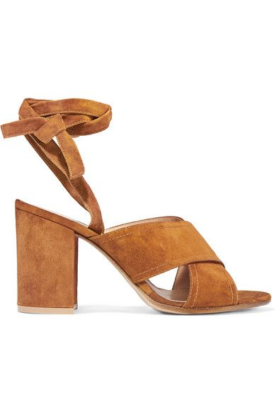 """For Spring '16, Gianvito Rossi explored """"denser volumes, sensual shapes and a new, relaxed elegance."""" These tan suede sandals have elegant ankle ties, supportive crossover straps and a chunky block heel. Style this Italian-made pair with summer dresses or cropped jeans."""