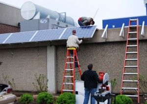 Kirkwood students installing photovoltaic solar panels on Jones Hall ~