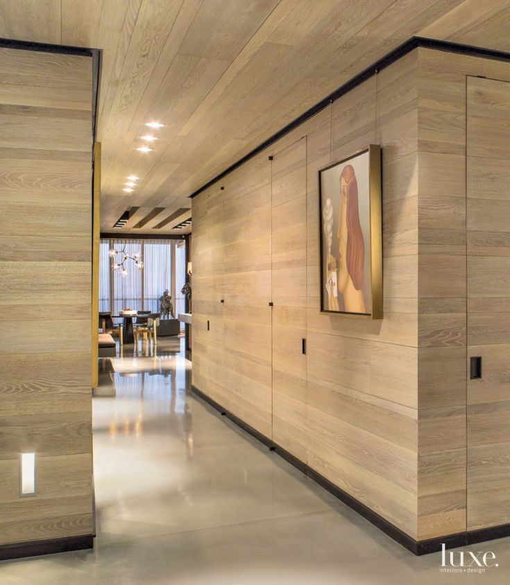 Contemporary Neutral Hall With Clad Walls