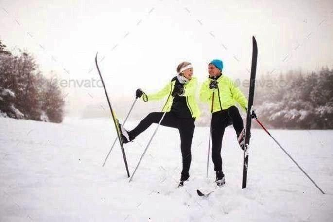 skiing. by halfpoint. Active senior couple cross-country skiing, having fun. Winter time.#country,S