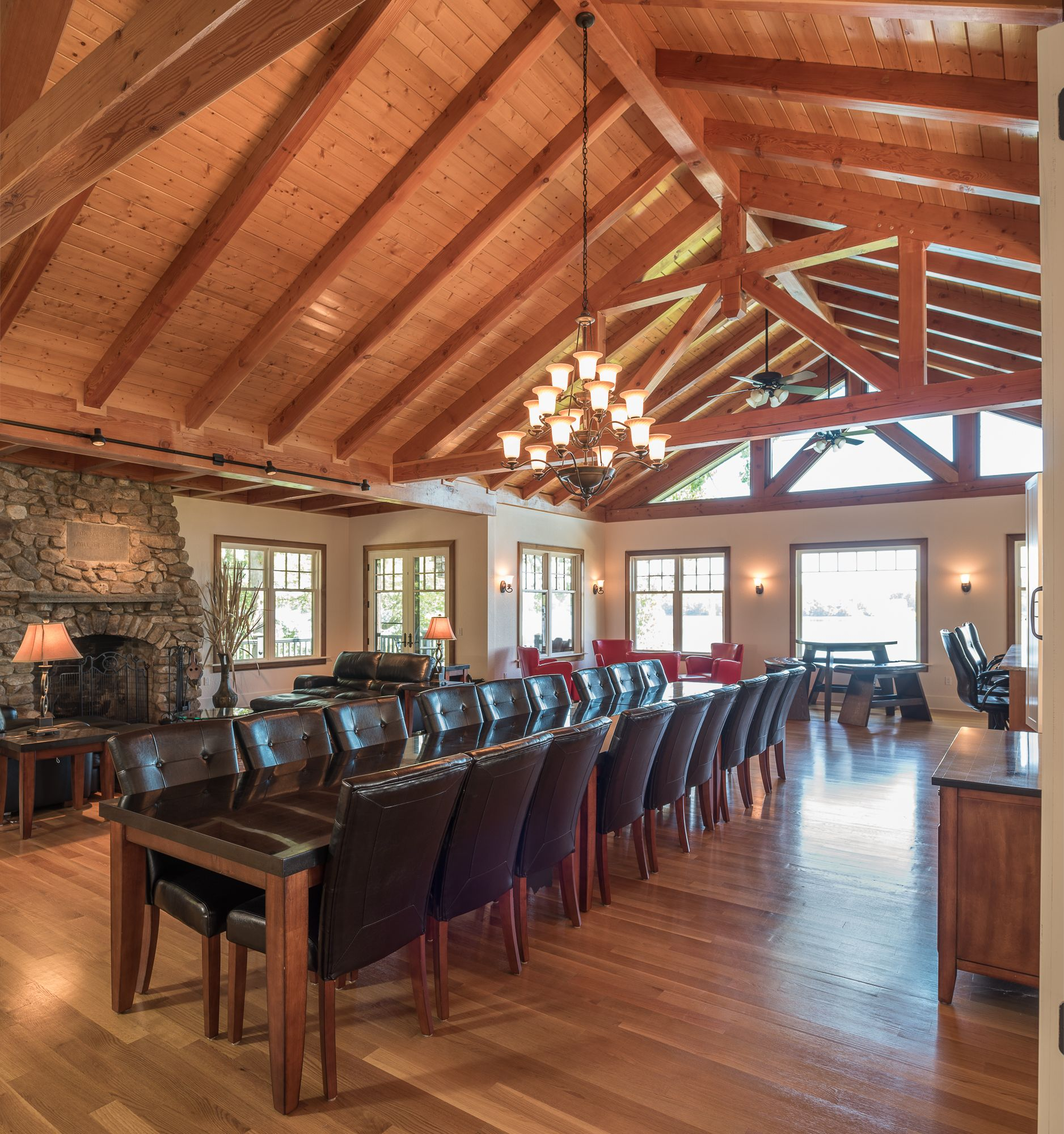 Timber Frame Great Room With Timber Trusses And Open Concept
