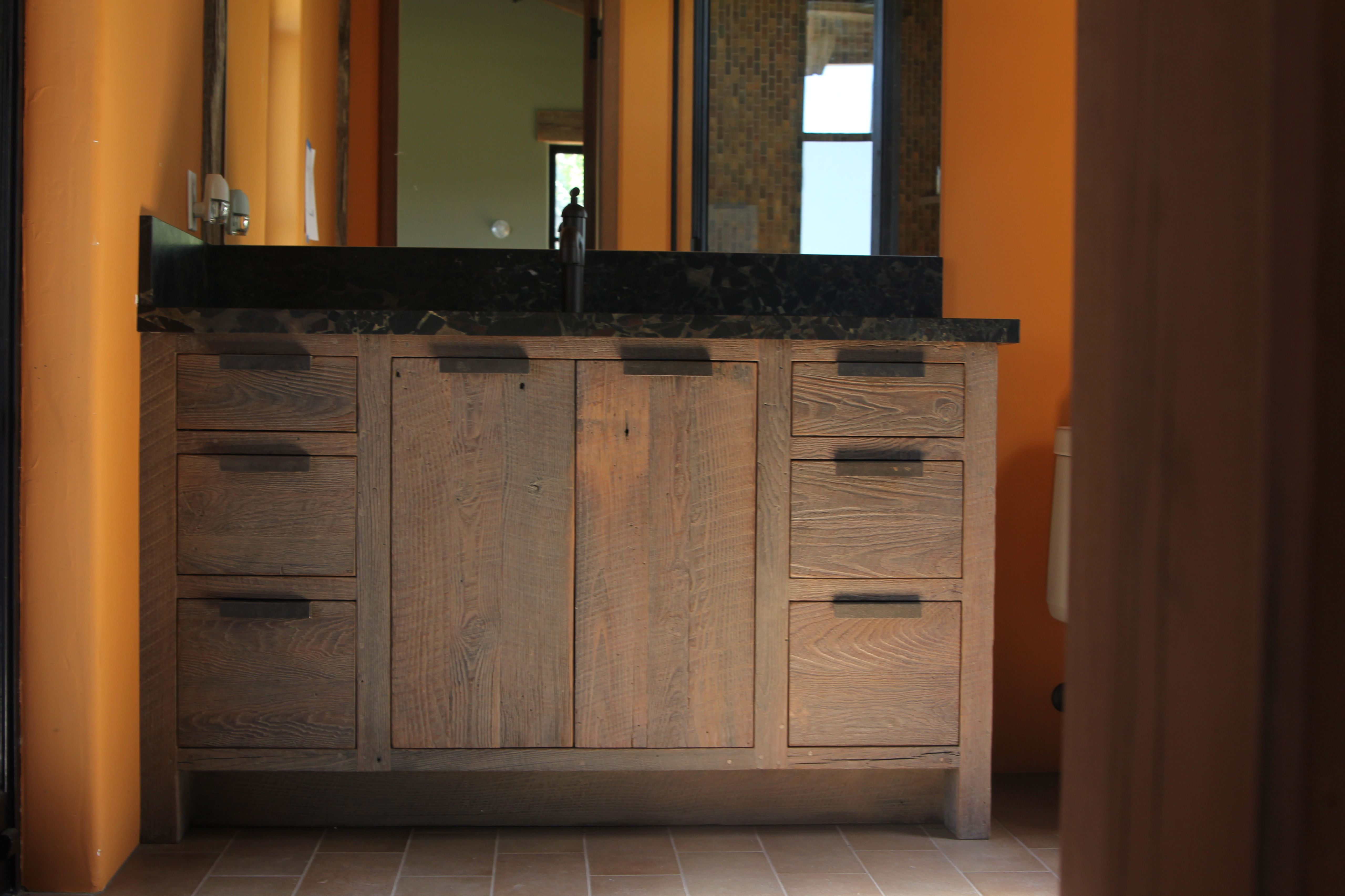 Vanities made from reclaimed wormy chestnut Custom made steel door