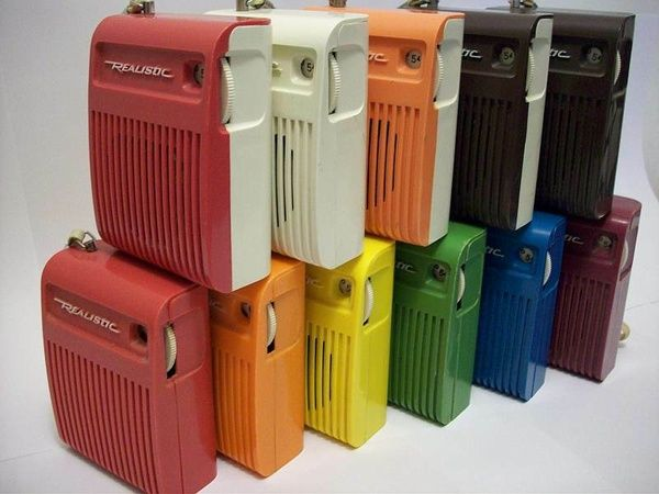Realistic brand transistor radios. Used to love listening to ghost stories when I was supposed to be sleeping.
