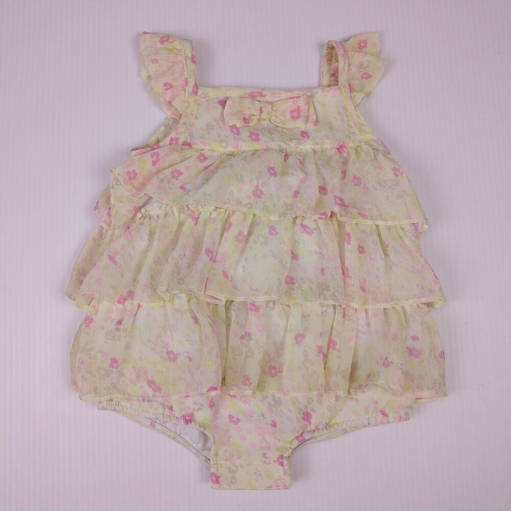 aafa896d7432 FAO Schwartz ruffle romper. Pale green crinkle chiffon ruffle layers in a  multi-colored floral print. Fully lined with bottom snap closure.