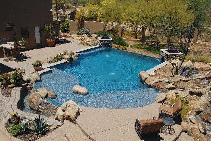 This backyard resort is a vacationer's dream--complete with an infinity pool and a river/stream supporting water feature that leads to both the pool and a separate spa. Dolphin Pools & Spas, Phoenix, Arizona http://www.luxurypools.com/