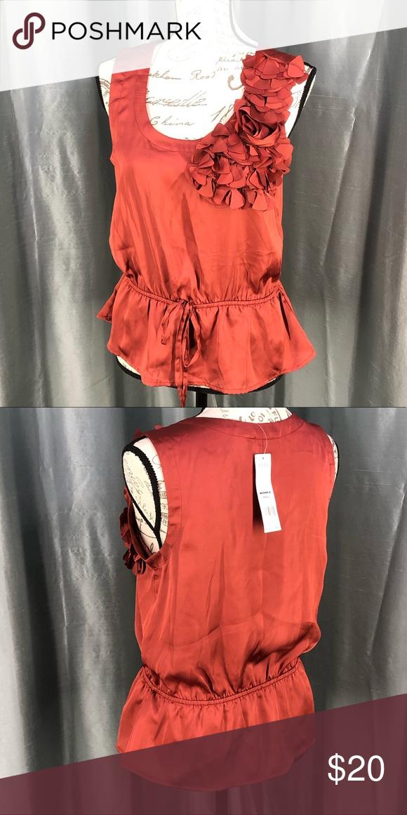"""Elle Jolie Provence copper blouse Elle Jolie Provence copper color  tie waist with floral embellishment on left shoulder area.  100% polyester  Armpit to armpit 18"""" Length 23"""" Size Small A07-01 Elle Tops Blouses"""