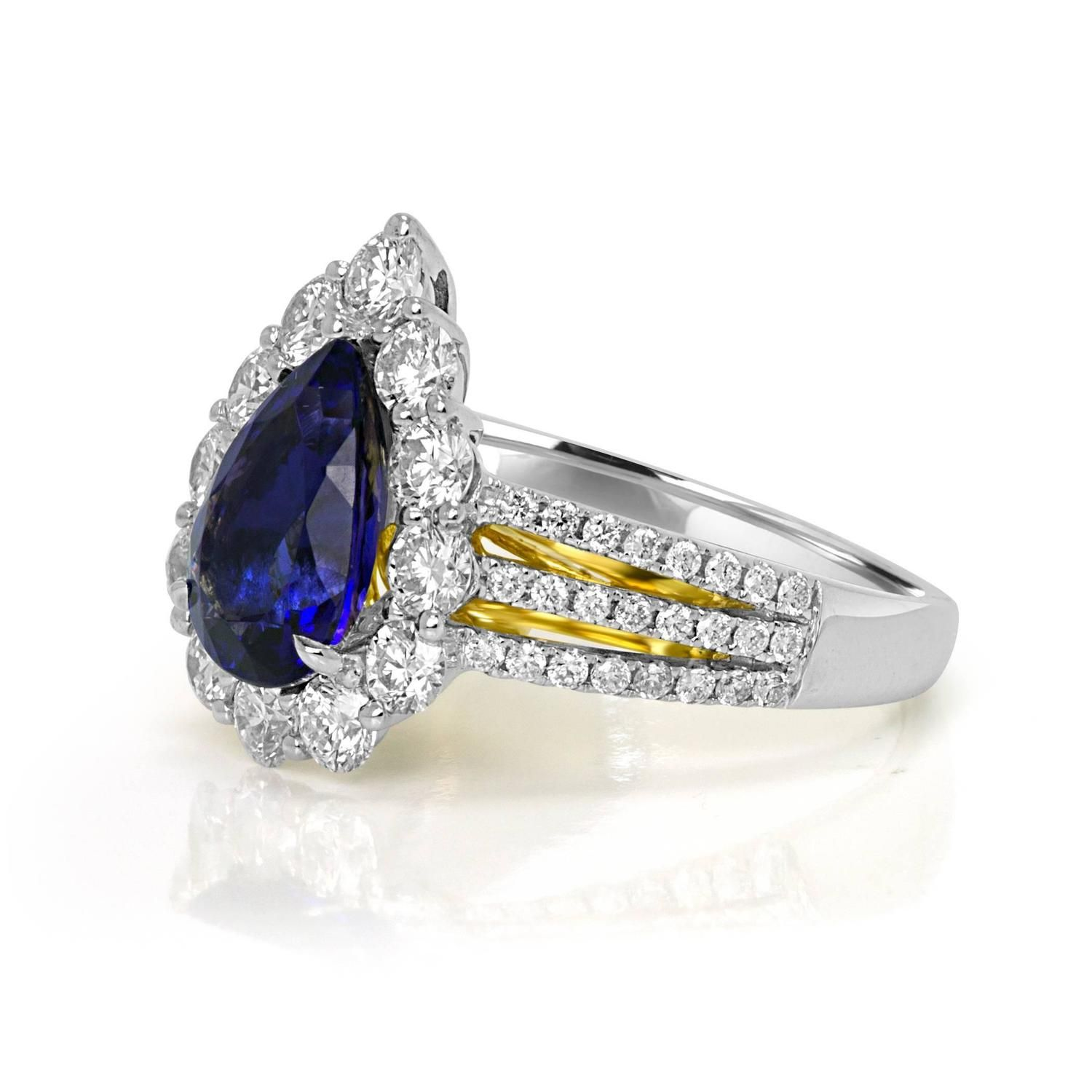 Tanzanite Diamond Two Color Gold Halo Ring