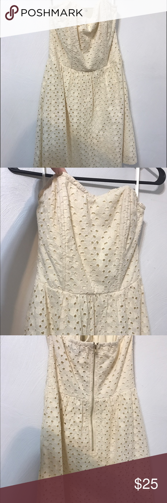 Francesca's strapless eyelet dress New with tags. Pretty strapless dress. No occasions to wear it. Knee length Francesca's Collections Dresses