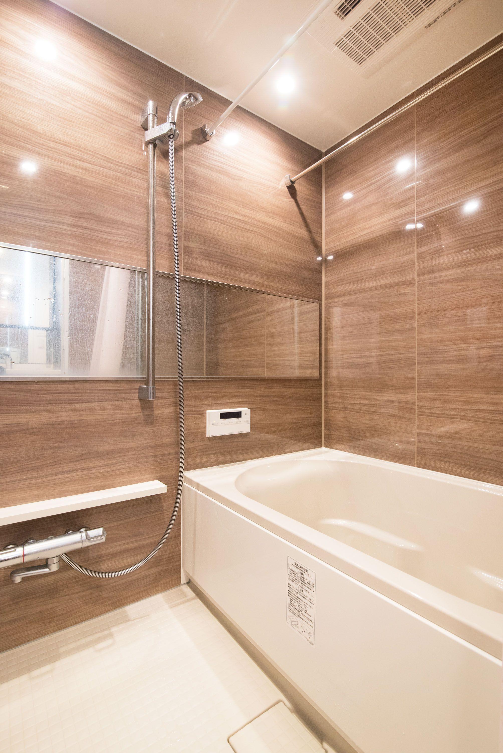 私たちの Just Size リノステージ リノベーション 中古マンション マンションリノベ 浴室 バスルーム ユニットバス 木目 明るい 落ち着いた 高級感 インテリア ユニットバス 浴室 おしゃれ モダンなバスルームデザイン