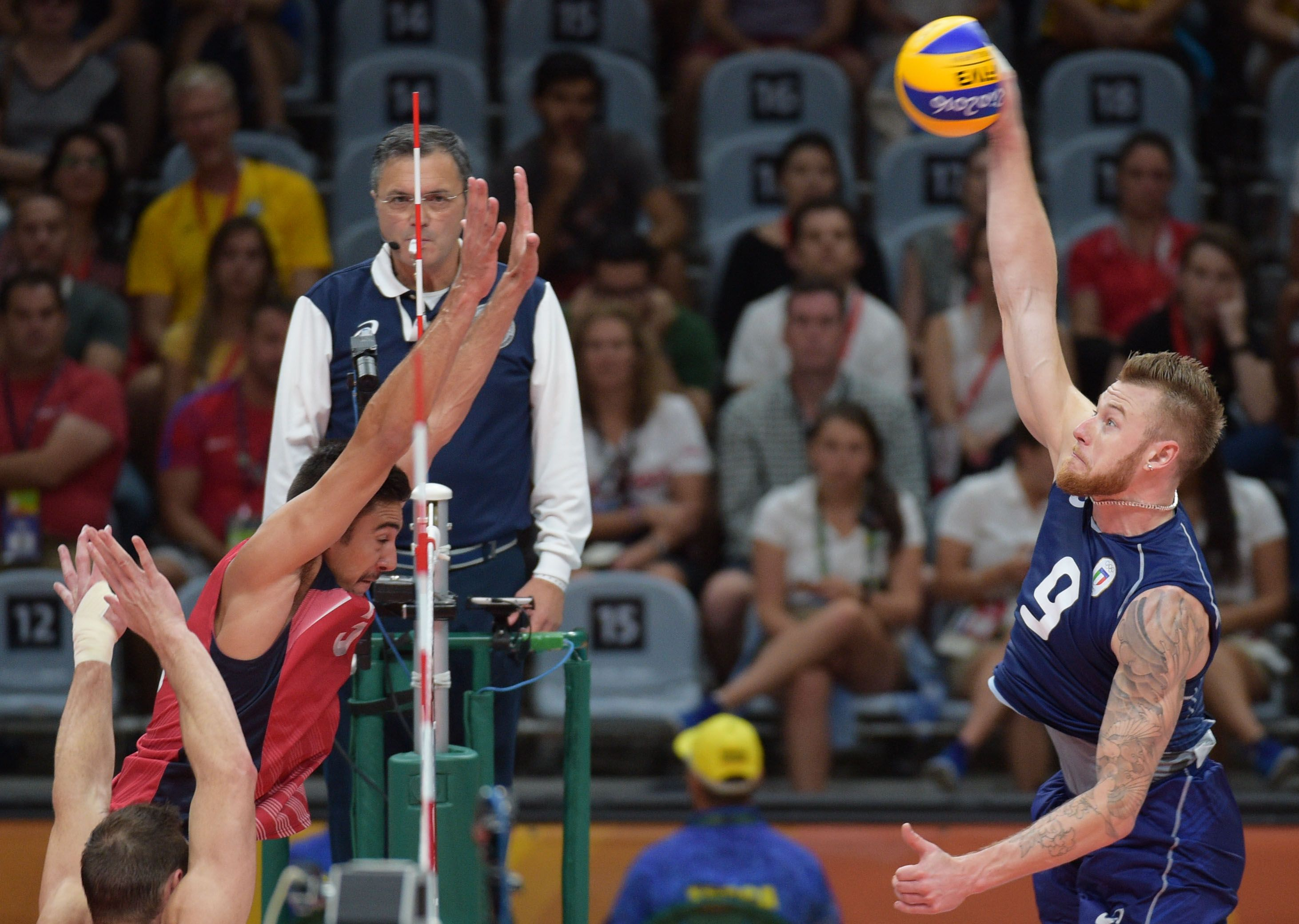 Ivan Zaytsev Spikes The Ball As Taylor Sander Of Team Usa Attempts To Block Him Good Luck With That In 2020 Volleyball Team Volleyball Players Volleyball