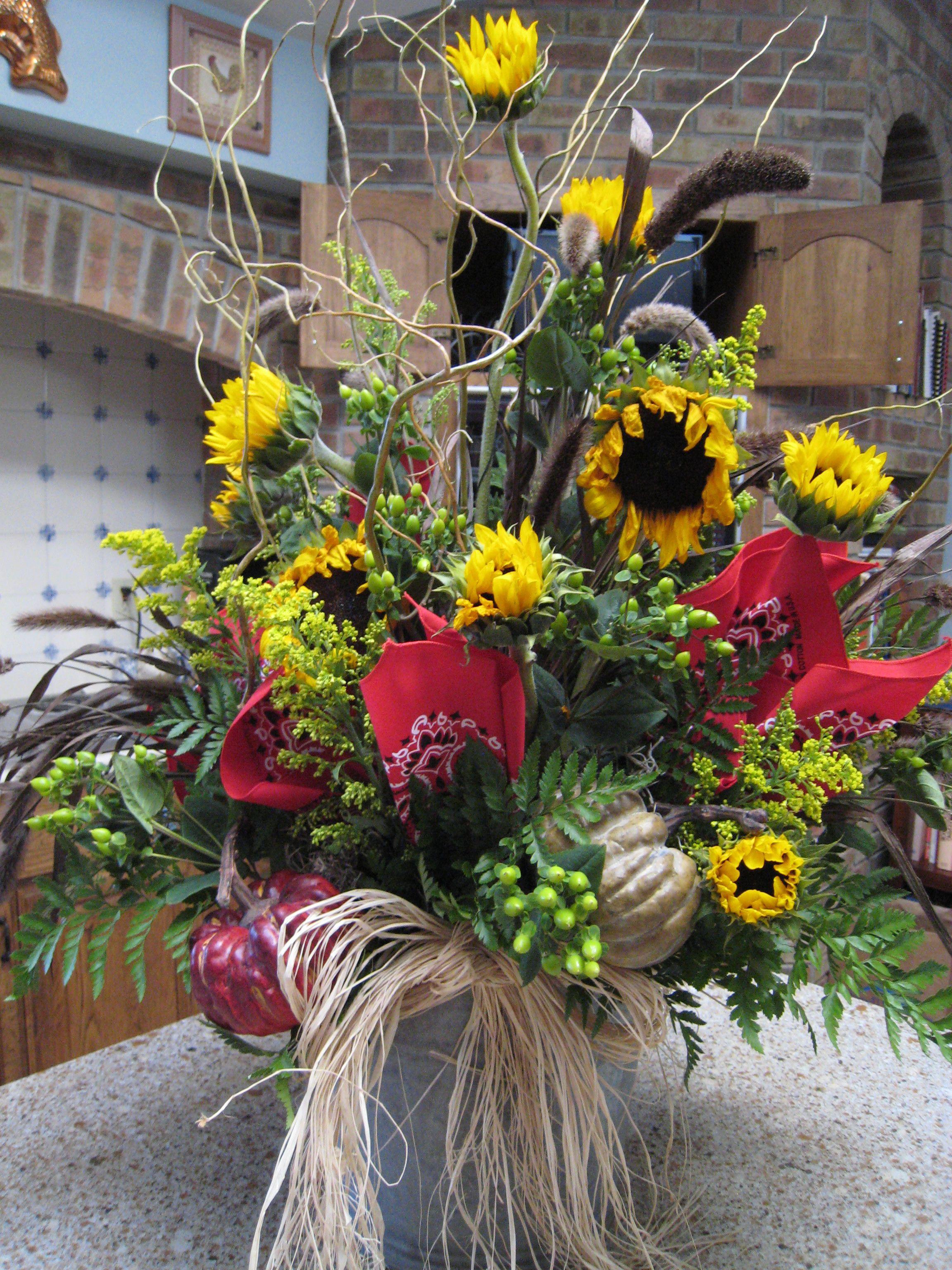 Bucket of sunflowers floral arrangements branches and for Floral arrangements with branches