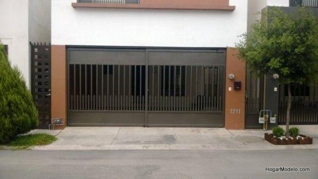 Puerta de garage de hierro con barrotes verticales for Portones de hierro para garage