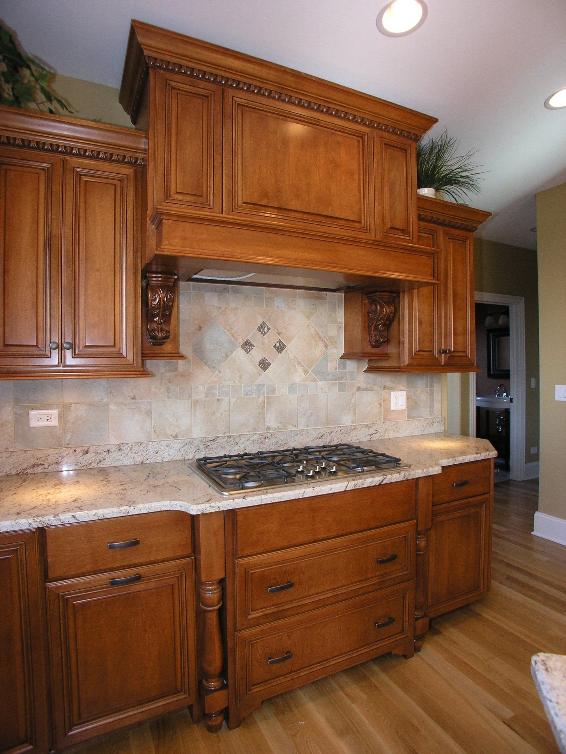 Custom cabinets, tile backsplash and gas cooktop adorn this beauty ...