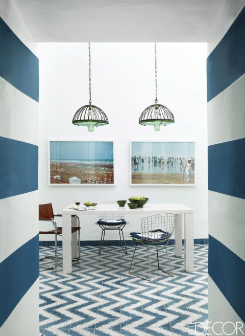 Nautical dining room with striped walls and blue and white tiled floors