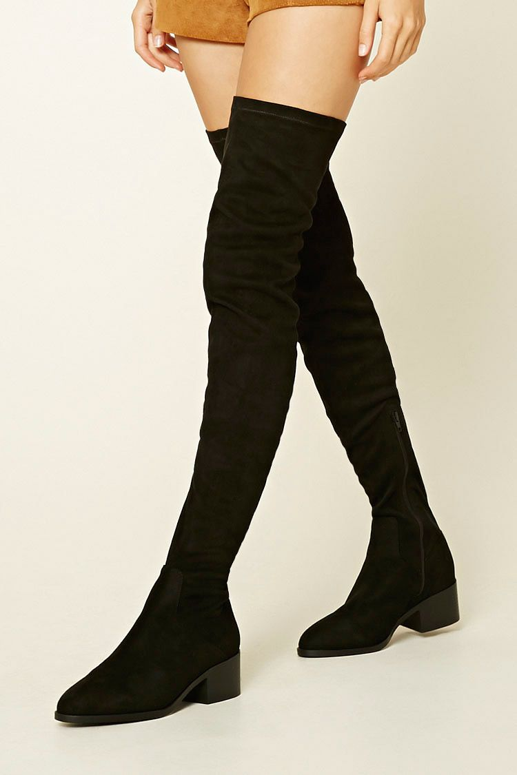 9dffa71f12e A pair of thigh-high faux suede boots featuring a pointed toe, side ...
