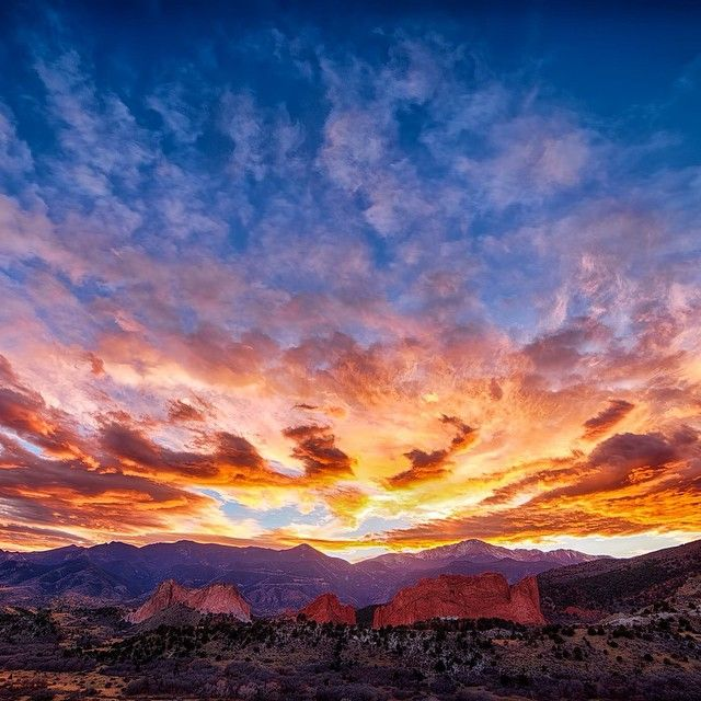 A Beautiful Sunset Behind Pikes Peak And Garden On The