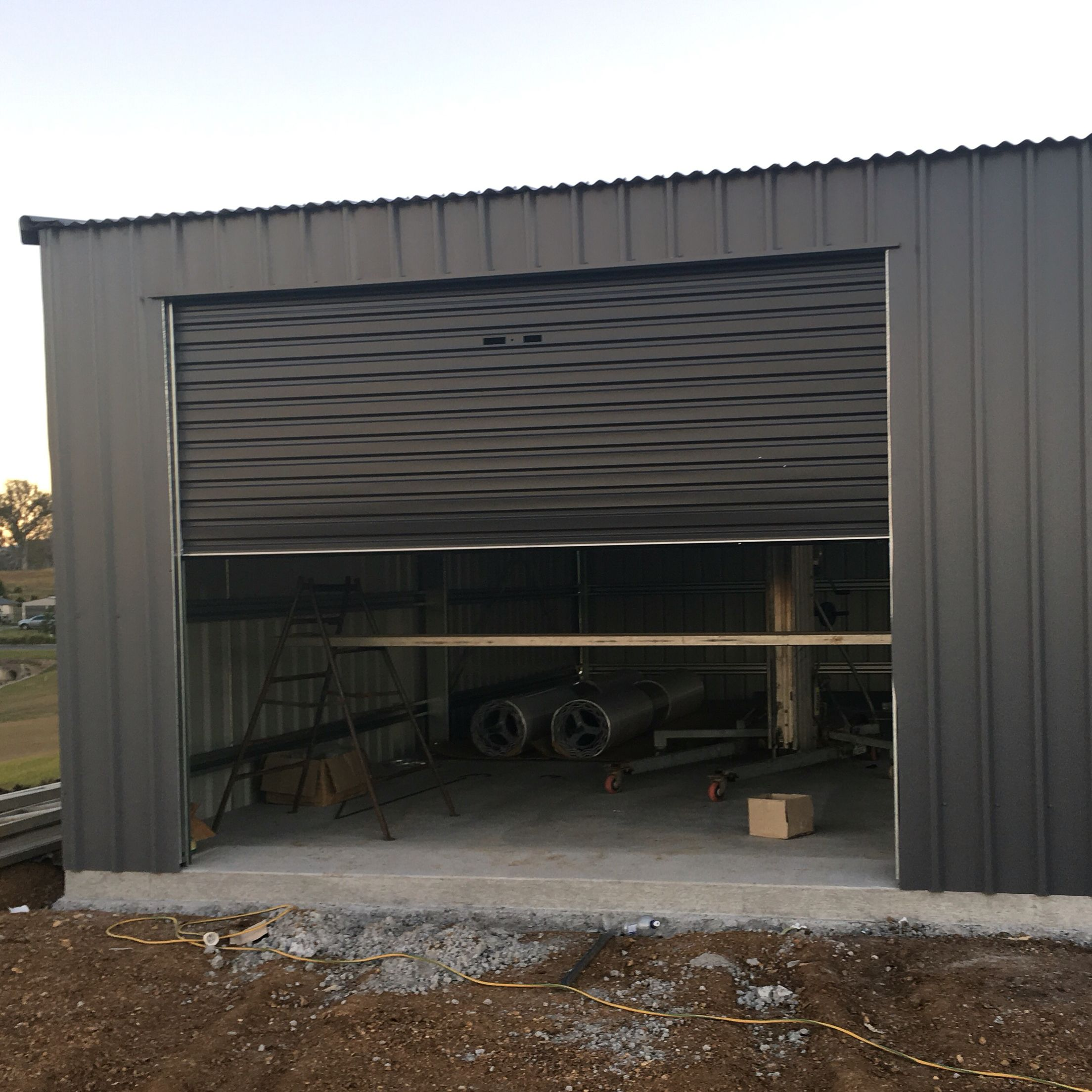 Basalt Colorbond Shed With Monument Roller Doors First House Build
