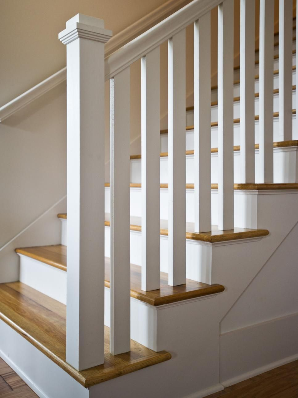 a square post and double handrail lead the way up this white wooden rh pinterest com white wood spiral staircase black and white wood staircase