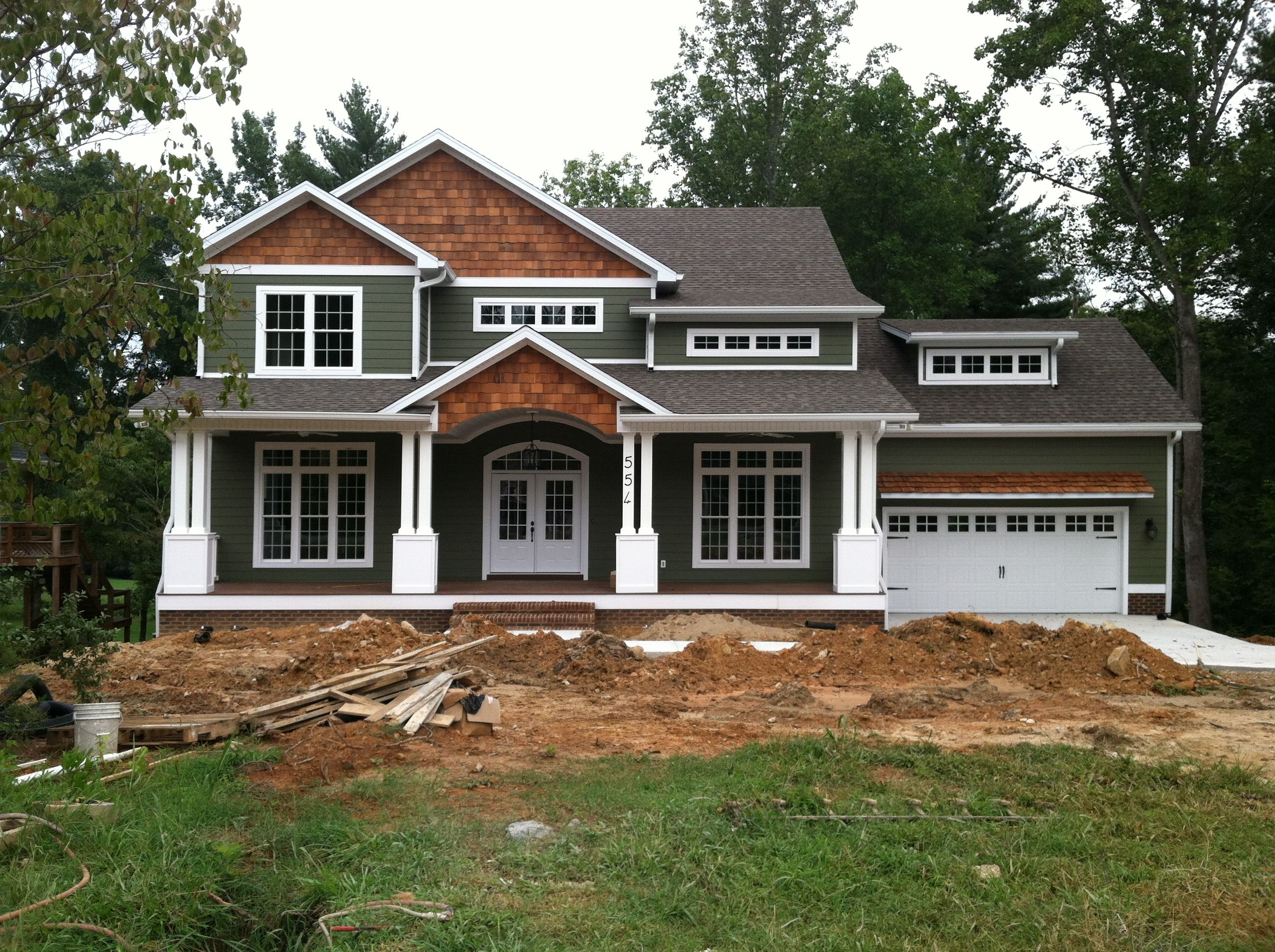 Craftsman style home turn the garage to the side change the color and add some rock work - Red exterior wood paint plan ...