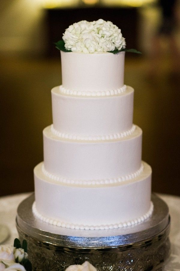 wedding cakes in lagunbeach ca%0A classic four tier wedding cake topped with hydrangeas