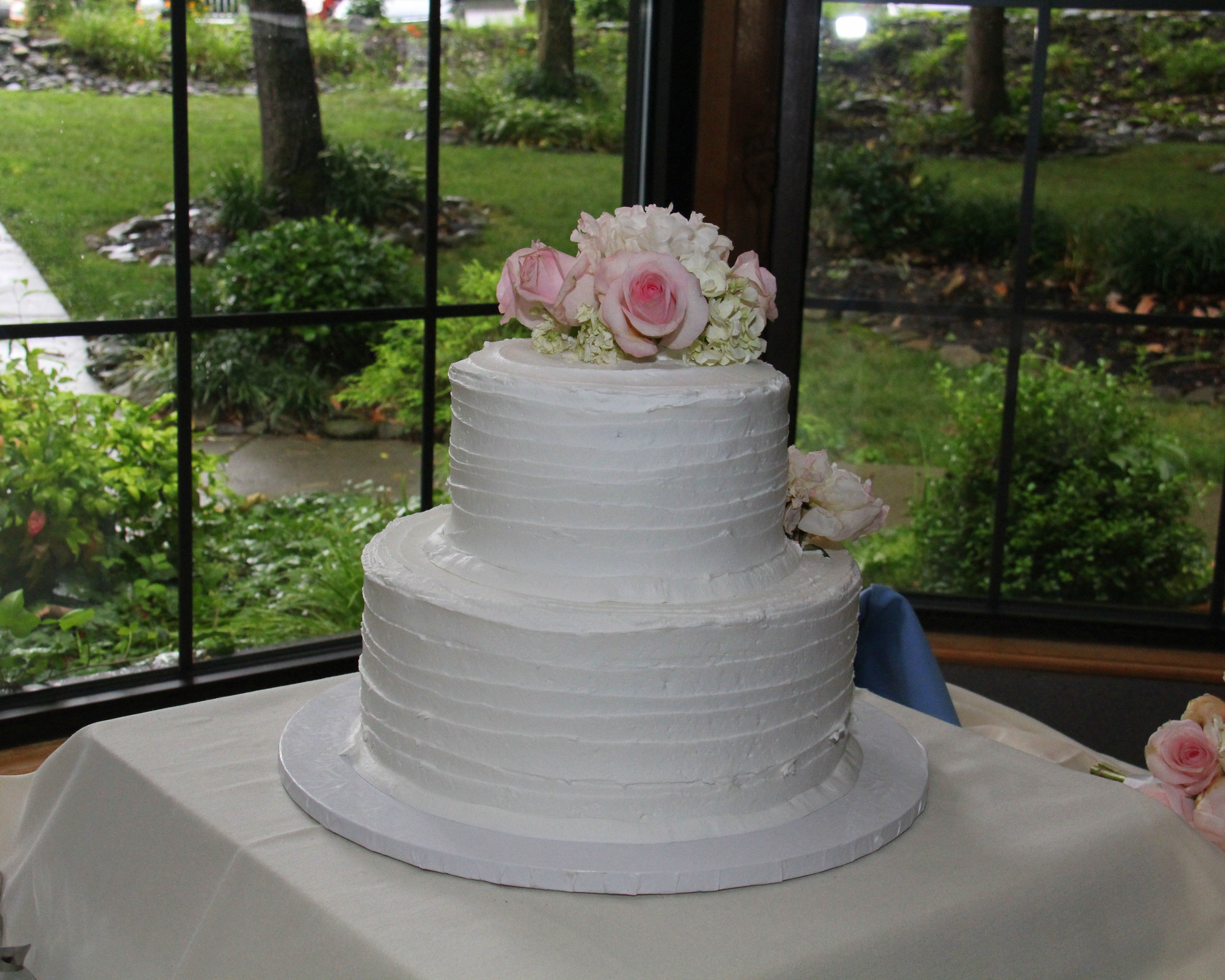 Textured Round 2 Tier Butter Cream Iced Wedding Cake With Fresh Floral Topper