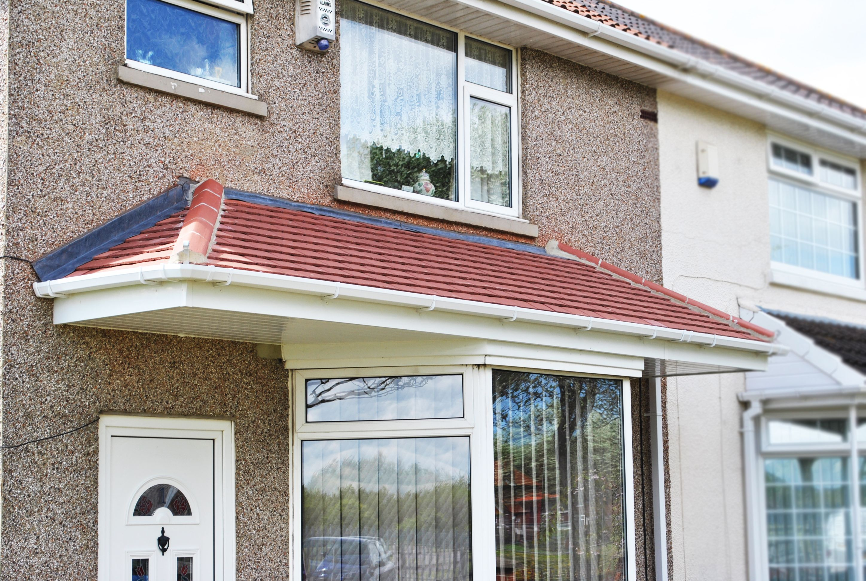 Beautiful Tiled Canopy above a Bay window and Front Door