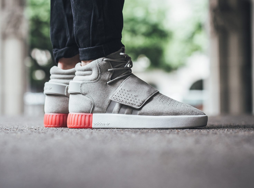 e54c7e1fe4df The adidas Tubular Invader Strap in sesame red is showcased. Look for the  model at select adidas stores…