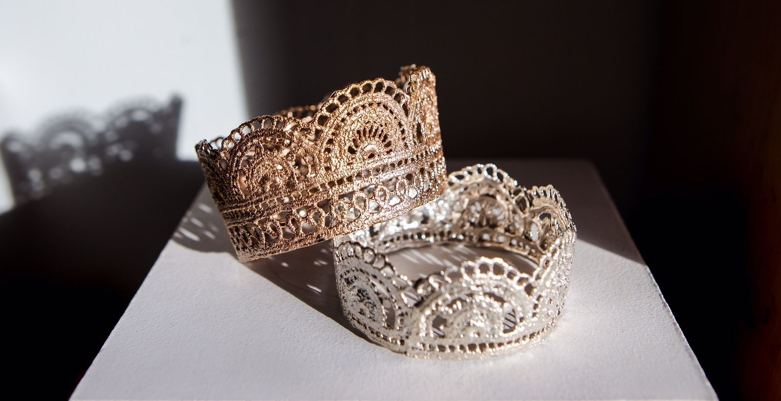 Two of Gabe's cuff bracelets, made from a lace veil.