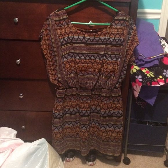 dress tribal design, pinches in a waist with elastic band, covers chest, back v cut with 3 strings (pic 3) good condition jcpenney Dresses Mini