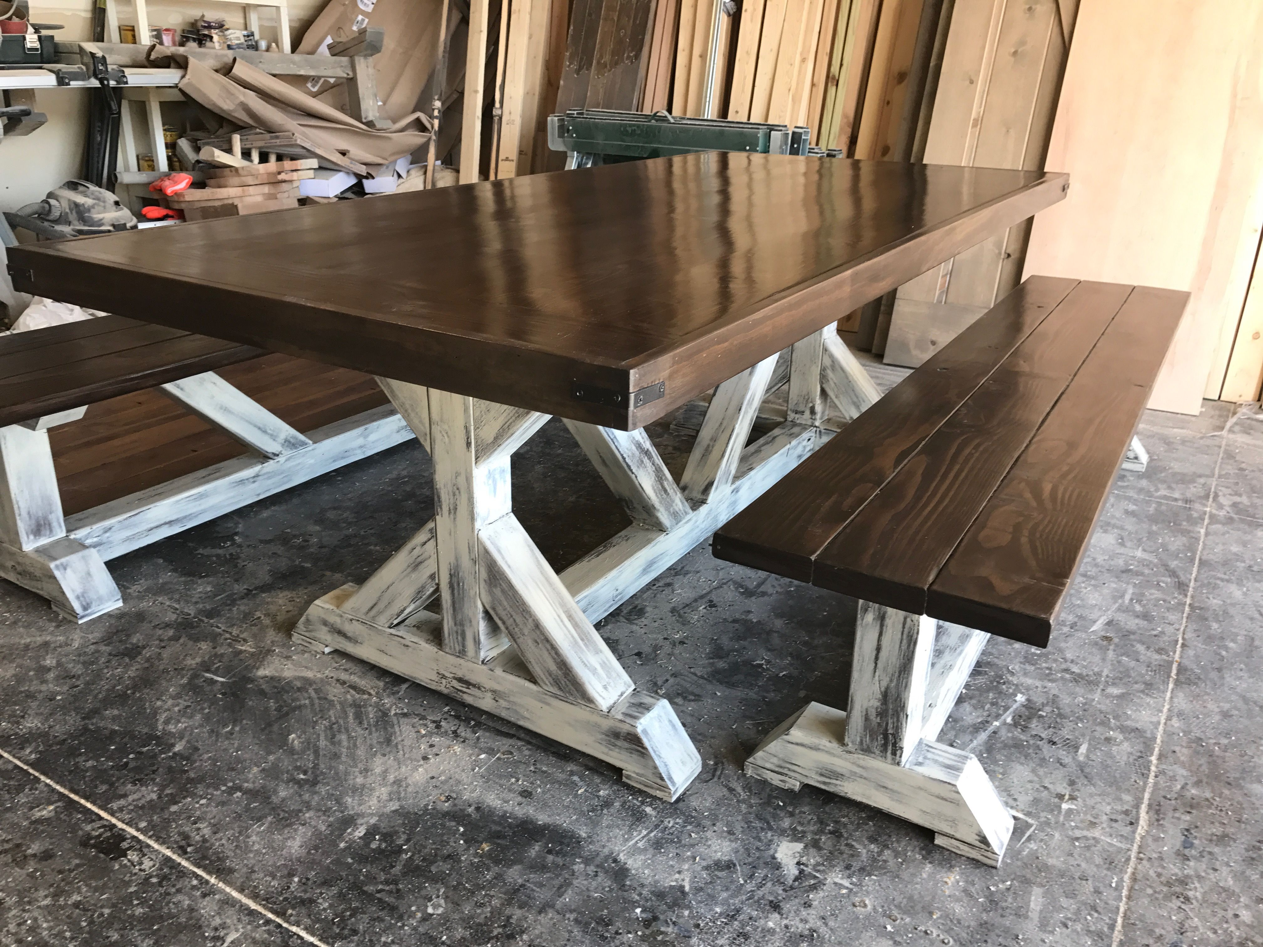 Rustic farm table with white cream washed legs and metal