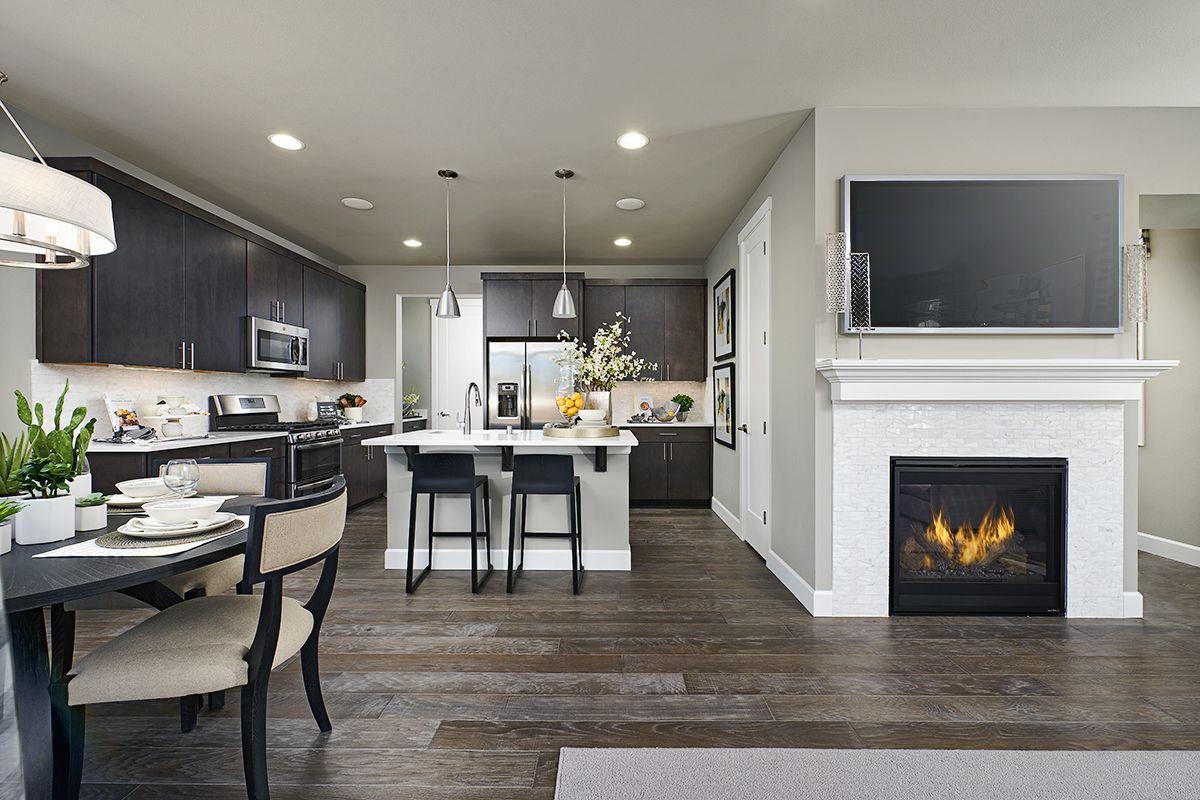 a cozy fireplace Elbert model home kitchen Edgewood
