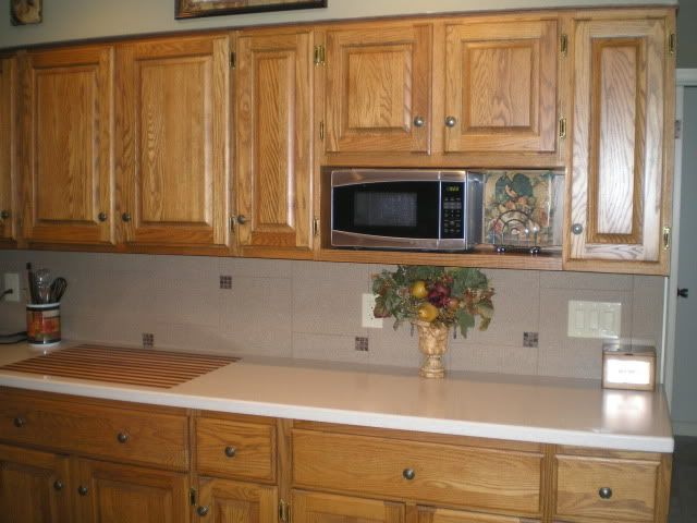 Microwave oven over the counter micrwowave ovens pinterest small shelves and upper cabinets - Small space microwave photos ...