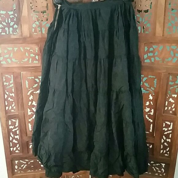 "Vintage Black Full Slip Petticoat Probably 1950s full black tiered petticoat that can be worn as a skirt. No tags. Likely homemade. Metal zipper. Missing the hook portion of the hook and eye. Feels like a very stiff nylon. I washed it and it came out crinkly, so it probably needs to be dry cleaned. Measures about 10"" flat across waist with no give and is about 26"" long. In fair to good vintage condition. Vintage  Skirts A-Line or Full"