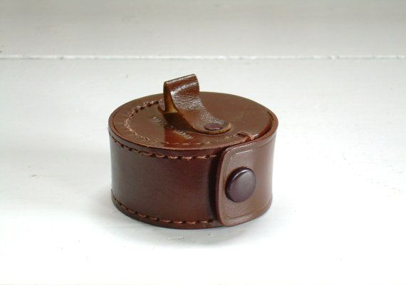 Vintage Leather Earbud Case    This sturdy leather case originally held an old school single earphone but will accommodate modern ear buds. Rich warm brown leather with very little signs of age and use. Snap closure is in good working order. Made in Japan.    Measures approx. 2 1/4 diameter, 1 1/4 thick.    I am always happy to combine shipping when practical. Please contact me with the items you would like to purchase and I will send you a personalized shipping quote.