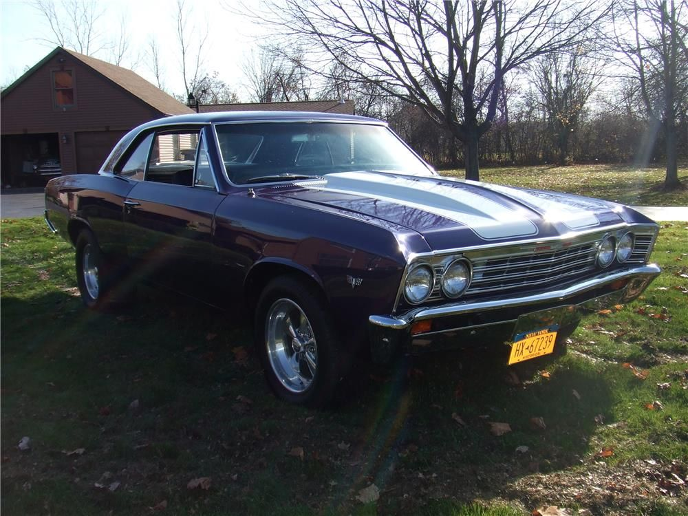 This 1967 Chevrolet Chevelle Malibu Is Dressed In A Beautiful Stunning Iridescent Blue Purple Urethane Paint Job With White Rally Stripes Although Not An