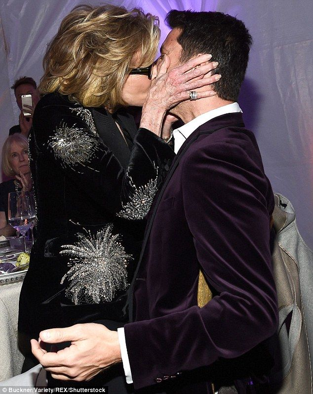 She's not shy: Jane Fonda leapt on a stunned executive lap and gave him a kiss at the UCLA Institute Of The Environment And Sustainability annual gala on Thursday