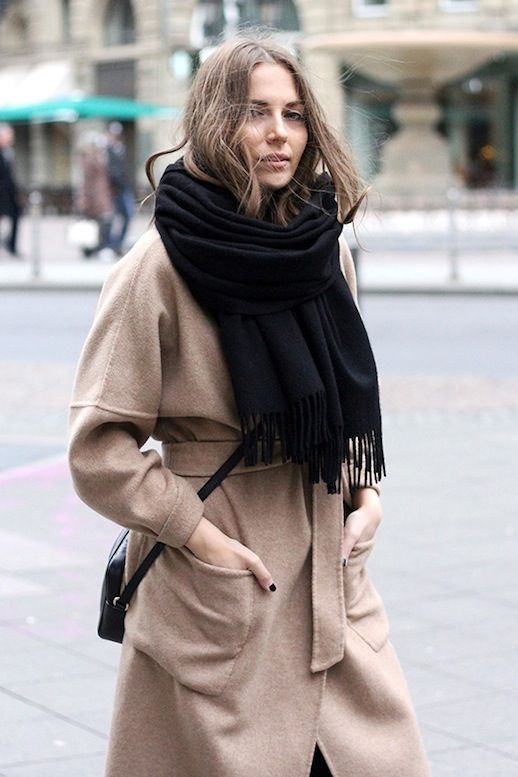 33dc86d5c Vanja wears an oversized black scarf over her wrap camel coat. This blogger  confirms that you can never go wrong with pairing black and camel!