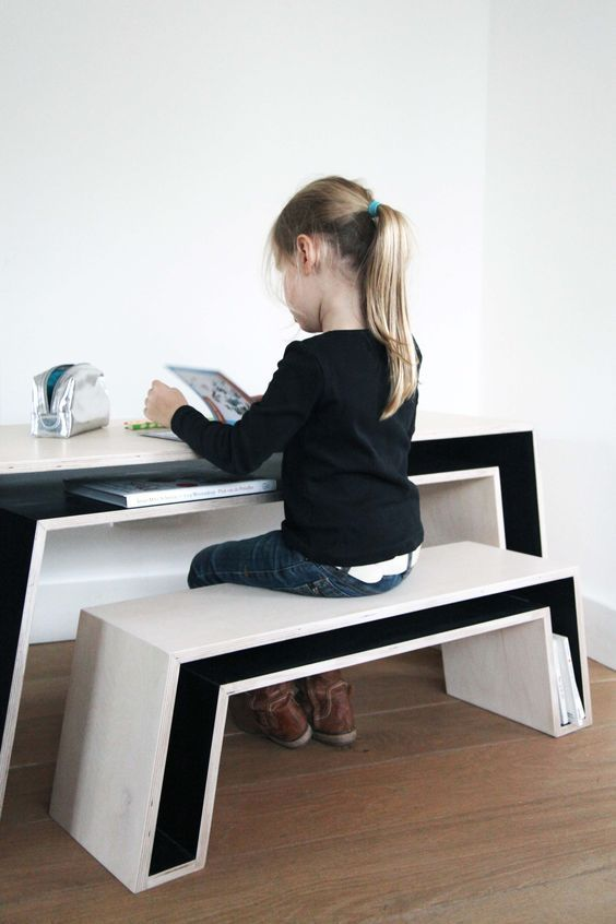 A Desk And A Bench With Storage Compartments That Save A Lot Of Space