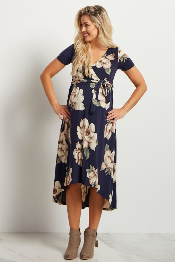 10704c7297da0 A new and different take on your favorite wrap dress is here! You'll look  stunning in this gorgeous floral printed hi-low maternity dress. With its  midi ...