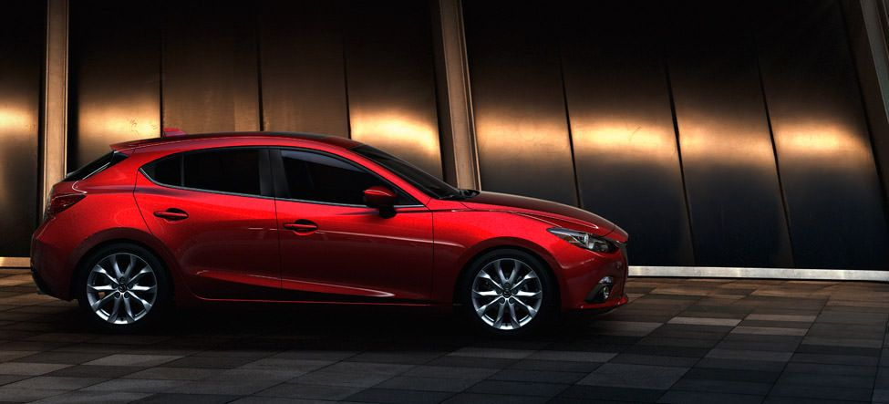 2015 Mazda 3 hatchback. Omg I love this! I've always wanted a car this color of red<3 my favorite