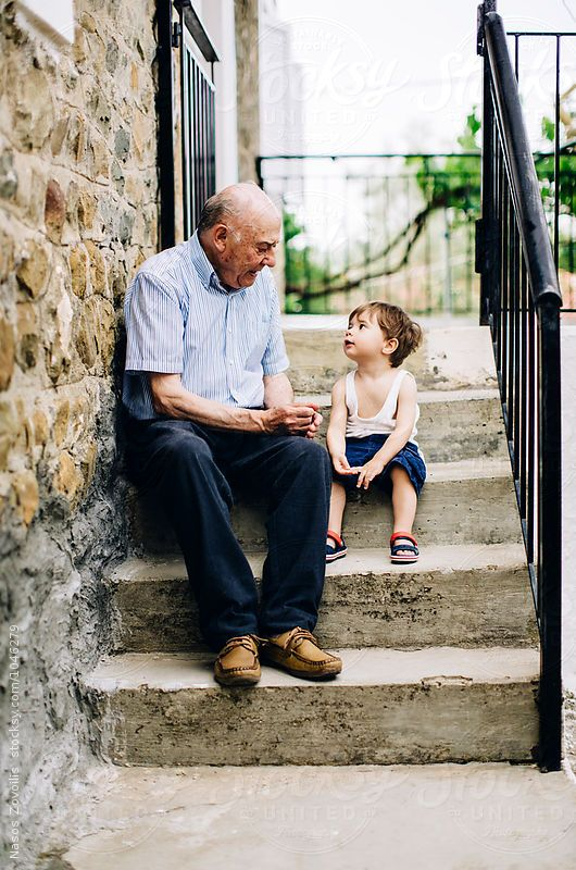 Grandfather talking to his grandson outdoor by Nasos Zovoilis #grandkidsphotography
