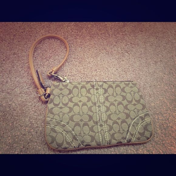Coach wristlet Has a small pen mark (shown), otherwise in great shape. Coach Bags Clutches & Wristlets