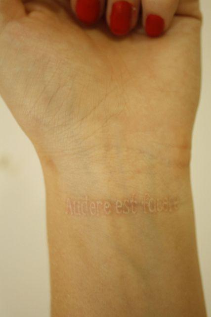 White ink wrist tattoo