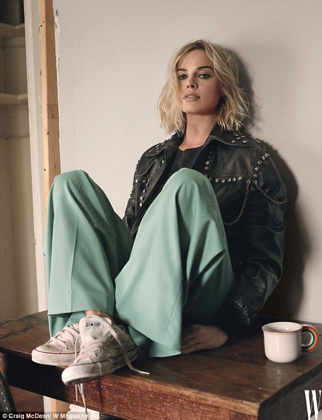 Glam in a Gucci jacket: Margot Robbie has leaped to the defense of disgraced figure skater Tonya Harding, whom she plays in the new biopic I, Tonya, in W