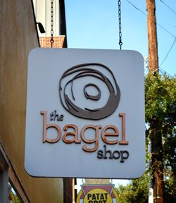 Bagel And Business Name On A Sign