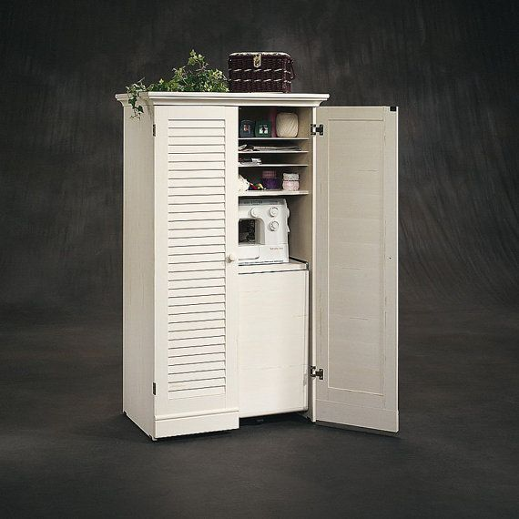 This One Of A Kind Craft Armoire With Fold Out Table Offers Storage So Perfect You Dont Have To Devote Craft Armoire Craft Storage Furniture Sewing Furniture
