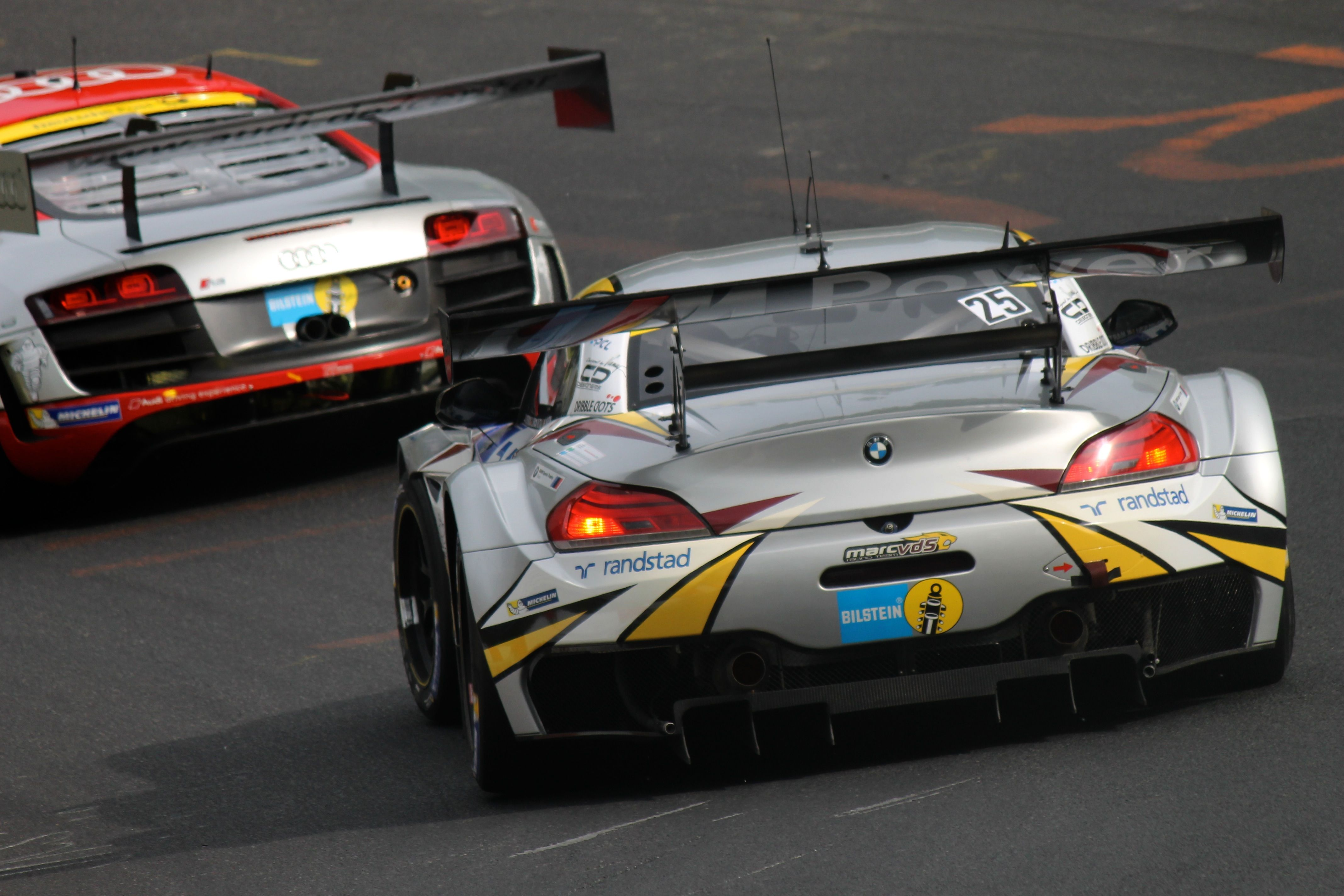 A Marc VDS BMW Z4 chases an Audi R8 at the practice for the 2015 24 Hours Race