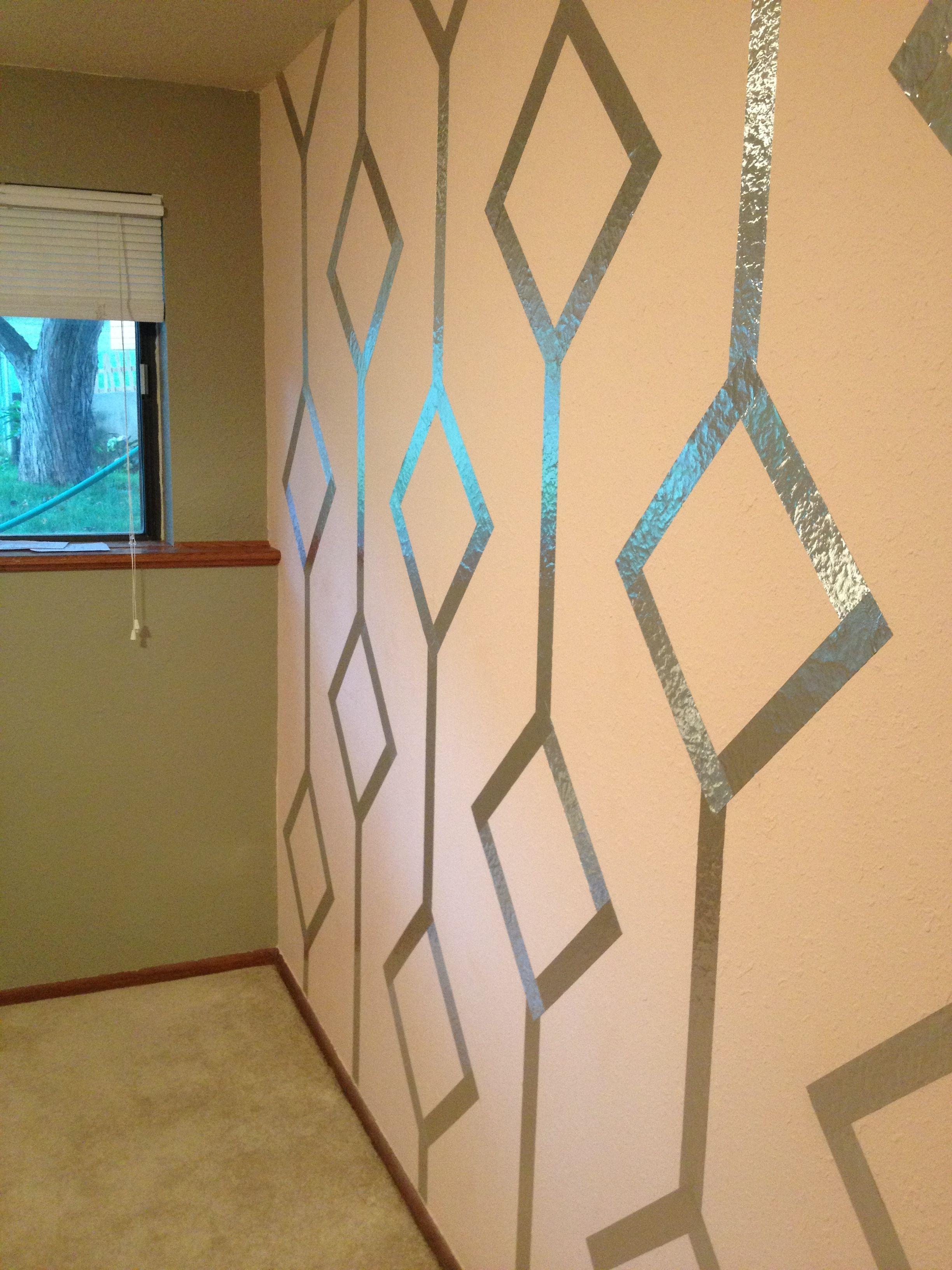 Foil tape design on light pink wall. Light grey greige walls ...